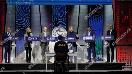 From left to right, Jeff Burningham, Aimee Winder Newton, Spencer Cox, Jon Huntsman Jr., Greg Hughes and Thomas Wright stand on the stage during a debate for Utah's 2020 gubernatorial race, in Salt Lake City. Six candidates vying for the GOP nomination in the Utah governor's race meet for their first debate. The debate is part of the Silicon Slopes Tech Summit, a conference for the state's burgeoning tech sector