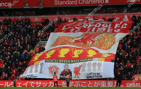 1st February 2020; Anfield, Liverpool, Merseyside, England; English Premier League Football, Liverpool versus Southampton; Liverpool fans pass a giant banner along the lower tier of the Sir Kenny Dalglish Stand prior to the kick off
