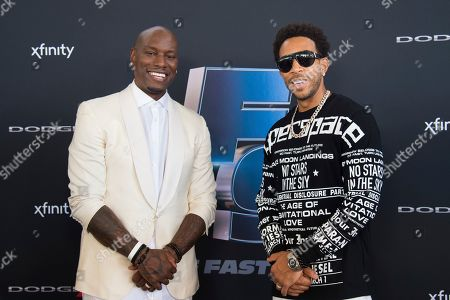 """Tyrese Gibson, Ludcaris. Record artists Tyrese Gibson, left, and Ludacris attend the the Road to """"Fast & Furious 9"""" Concert at Maurice A. Ferré Park, in Miami, Fla"""