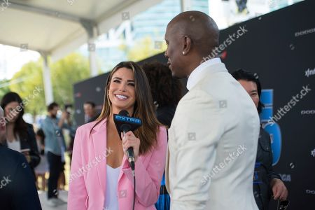 """Jennifer Lahmers, Tyrese Gibson. Jennifer Lahmers, left, interviews Tyrse Gibson on the red carpet at the Road to """"Fast & Furious 9"""" Concert at Maurice A. Ferré Park, in Miami, Fla"""