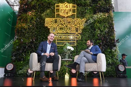 Peyton Manning, former quarterback of the Denver Broncos, speaks on stage with Joe Tessitore at the DIRECTV NFL SUNDAY TICKET Lounge, in Miami, FL