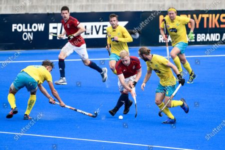 Stock Image of 2nd February 2020; Sydney Olympic Park, Sydney, New South Wales, Australia; International FIH Field Hockey, Australia versus Great Britain; Rupert Shipperley of Great Britain evades a tackle from Tim Howard of Australia