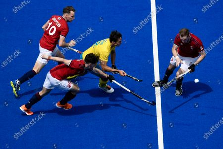 Stock Picture of 2nd February 2020; Sydney Olympic Park, Sydney, New South Wales, Australia; International FIH Field Hockey, Australia versus Great Britain; Tom Craig of Australia runs past Tom Sorsby of Great Britain