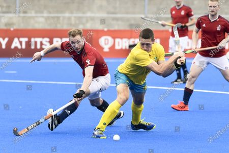 Stock Picture of 2nd February 2020; Sydney Olympic Park, Sydney, New South Wales, Australia; International FIH Field Hockey, Australia versus Great Britain; Kurt Lovett of Australia prepares to take a shot as David Ames of Great Britain tries to block