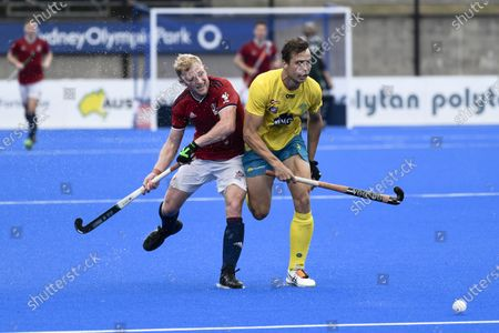 2nd February 2020; Sydney Olympic Park, Sydney, New South Wales, Australia; International FIH Field Hockey, Australia versus Great Britain; Rupert Shipperley of Great Britain and Tom Craig of Australia chase a through ball