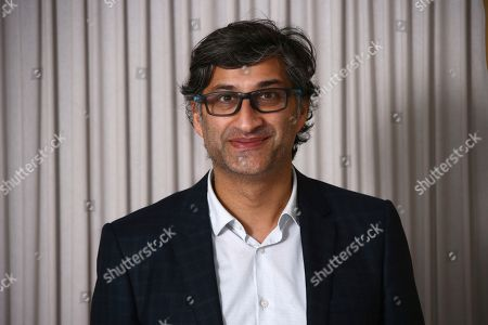 Asif Kapadia poses for photographers upon arrival at the Academy Nominees Reception, in central London