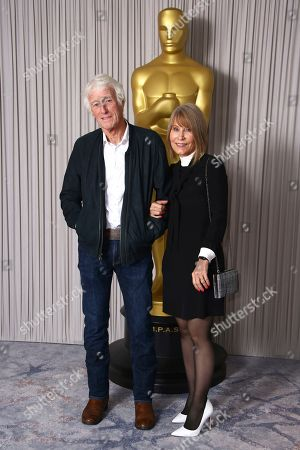 Roger Deakins, Isabella James Purefoy Ellis. Roger Deakins and his wife Isabella James Purefoy Ellis pose for photographers upon arrival at the Academy Nominees Reception, in central London