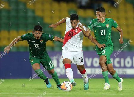 Stock Image of Jose Rivera, Rodrigo Cabrera, Hector Sanchez. Peru's Jose Rivera, center, fights for the ball with Bolivia's Rodrigo Cabrera, left, and Hector Sanche during a South America Olympic qualifying U23 soccer match at the Centenario stadium in Armenia, Colombia