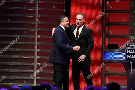 Kevin Harvick, right, introduces Tony Stewart at the NASCAR Hall of Fame induction ceremony in Charlotte, N.C