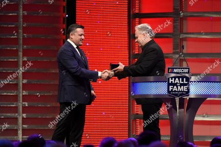 Gene Haas, right, presents the Hall of Fame ring to Tony Stewart at the NASCAR Hall of Fame induction ceremony in Charlotte, N.C