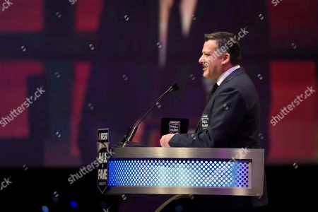 Tony Stewart talks about his career as a driver and team owner during the NASCAR Hall of Fame induction ceremony in Charlotte, N.C