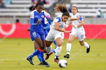 Costa Rica forward Raquel Rodriguez (11) falls while chasing the ball as she is pushed from behind by Haiti forward Nerilia Mondesir (10) during the first half of a CONCACAF women's Olympic qualifying soccer match, in Houston