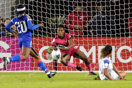 Haiti goalkeeper Kerly Theus, middle, tries to block the kick for a score by Costa Rica forward Raquel Rodriguez, right, as Haiti midfielder Kethna Louis (20) watches during the second half of a CONCACAF women's Olympic qualifying soccer match, in Houston