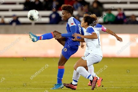 Haiti midfielder Melchie Dumonay, left, brings down the ball in front of Costa Rica forward Raquel Rodriguez during the second half of a CONCACAF women's Olympic qualifying soccer match, in Houston