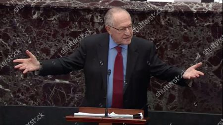 In this image from United States Senate television, Alan Dershowitz tries to explain his statement from Tuesday evening where he seemed to say if a president sees their own reelection as being in the national interest he cannot be considered corrupt unless it also involves a crime, during question-and-answer portion of the impeachment trial of US President Donald J. Trump in the US Senate in the US Capitol in Washington, DC.