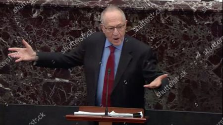 Stock Image of In this image from United States Senate television, Alan Dershowitz tries to explain his statement from Tuesday evening where he seemed to say if a president sees their own reelection as being in the national interest he cannot be considered corrupt unless it also involves a crime, during question-and-answer portion of the impeachment trial of US President Donald J. Trump in the US Senate in the US Capitol in Washington, DC.