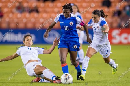 Haiti forward Nerilia Mondesir (10) attempts to get the ball past Costa Rica midfielder Raquel Rodriguez (11) and Costa Rica forward Melissa Herrera (7) during the 2nd half of a CONCACAF Olympic Qualifying soccer match between Haiti and Costa Rica at BBVA Stadium in Houston, TX. Costa Rica won the game 2 to 0