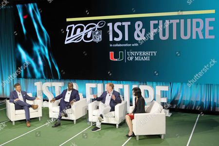 Stock Image of From left, host Dan Hellie, NFL Hall of Famer, Curtis Martin, NFL Commissioner Roger Goodell, and Michelle Lee, Vice-president of Amazon ML Solutions Lab sit on a panel at the 1st and Future competition on in Miami Beach, Fla. 1st and Future is the NFL's annual competition designed to spur innovation in player health, safety and performance