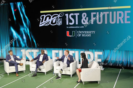 From left, host Dan Hellie, NFL Hall of Famer, Curtis Martin, NFL Commissioner Roger Goodell, and Michelle Lee, Vice-president of Amazon ML Solutions Lab, sit on a panel at the 1st and Future competition on in Miami Beach, Fla. 1st and Future is the NFL's annual competition designed to spur innovation in player health, safety, and performance