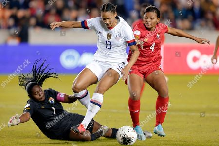 Panama goalkeeper Yenith Bailey (1) falls as U.S. forward Lynn Williams (13) jumps over her to score in front of Panama defender Hilary Jaen (4) during the first half of a CONCACAF women's Olympic qualifying soccer match, in Houston