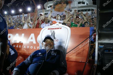 The head coach of Gimnasia y Esgrima, former Argentinian soccer player Diego Maradona, sits during a Superliga soccer match between Huracan and Gimnasia Esgrima at Tomas Duco stadium in n Buenos Aires, Argentina, 31 January 2020.