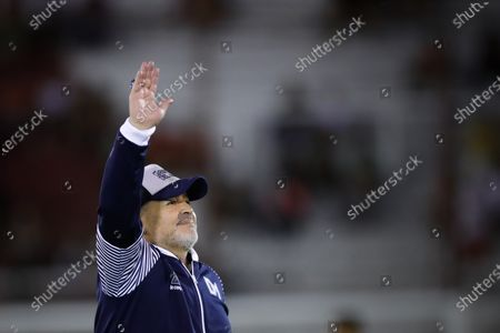 The head coach of Gimnasia y Esgrima, former Argentinian soccer player Diego Maradona, waves to fans during a Superliga soccer match between Huracan and Gimnasia Esgrima at Tomas Duco stadium in n Buenos Aires, Argentina, 31 January 2020.