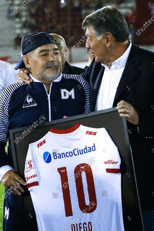 The head coach of Gimnasia y Esgrima, former Argentinian soccer player Diego Maradona (L), poses with former Argentinian soccer player Miguel Brindisi (R),during a Superliga soccer match between Huracan and Gimnasia Esgrima at Tomas Duco stadium in n Buenos Aires, Argentina, 31 January 2020.