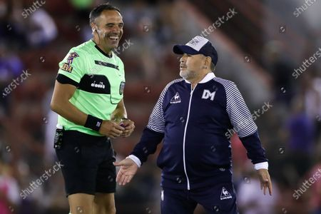 The head coach of Gimnasia y Esgrima, former Argentinian soccer player Diego Maradona, reacts next to referee Silvio Trucco during a Superliga soccer match between Huracan and Gimnasia Esgrima at Tomas Duco stadium in n Buenos Aires, Argentina, 31 January 2020.