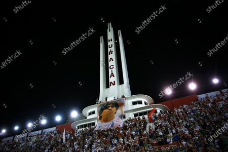Huracan's fans cheer for the head coach of Gimnasia y Esgrima, former Argentinian soccer player Diego Maradona, during a Superliga soccer match between Huracan and Gimnasia Esgrima at Tomas Duco stadium in n Buenos Aires, Argentina, 31 January 2020.