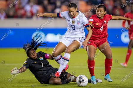 Stock Photo of United States forward Lynn Williams (13) gets the ball past Panama goalkeeper Yenith Bailey (1) and defender Hilary Jaen (4) prior to scoring a goal during the 1st half of a CONCACAF Olympic Qualifying soccer match between Panama and the United States of America at BBVA Stadium in Houston, TX. The United States won 8 to 0