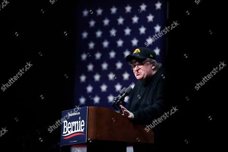 Filmmaker Michael Moore speaks during a campaign event for Democratic presidential candidate Sen. Bernie Sanders, I-Vt., in Clive, Iowa