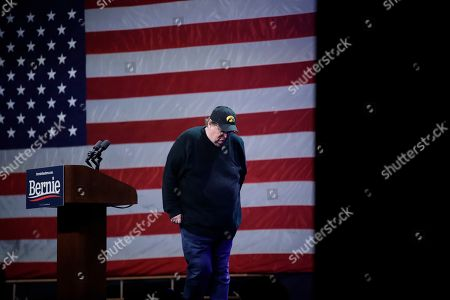 Filmmaker Michael Moore pauses while making a speech during a campaign event for Democratic presidential candidate Sen. Bernie Sanders, I-Vt., in Clive, Iowa