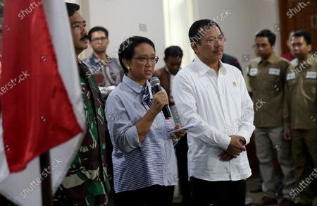 Indonesian Foreign Affairs Minister Retno Marsudi (C) gives a speech accompanied by Indonesian Health Minister Terawan Agus Putranto (R) and Indonesian Military Chief Marshall Hadi Tjahjanto (L), during a ceremony of humanitarian operation to pick up Indonesian from Wuhan, China during a press conference in Sukarno Hatta Airport, Banten, Indonesia, 01 February 2020. Indonesian government will evacuate at least 243 Indonesian from Wuhan, China with Boeing A330-300 Batik Air, Lion Group. The World Health Organization (WHO) has declared the novel coronavirus an international public health emergency.