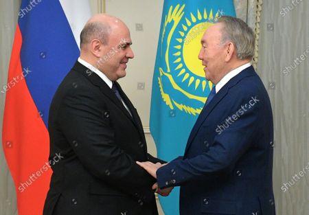 Kazakhstan's former president Nursultan Nazarbayev (R) shakes hands with Russian Prime Minister Mikhail Mishustin (L), during their meeting in Nur-Sultan, Kazakhstan, 01 February 2020.