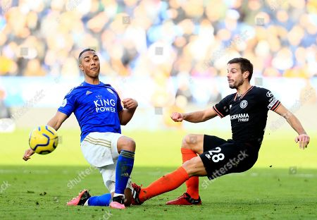 Leicester's Ricardo Pereira, left, duels for the ball with Chelsea's Cesar Azpilicueta during the English Premier League soccer match between Leicester City and Chelsea at the King Power Stadium, in Leicester, England