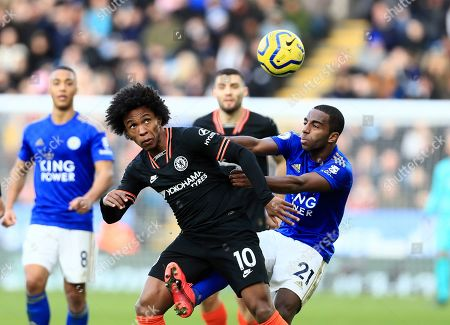 Chelsea's Willian, front left, duels for the ball with Leicester's Ricardo Pereira during the English Premier League soccer match between Leicester City and Chelsea at the King Power Stadium, in Leicester, England