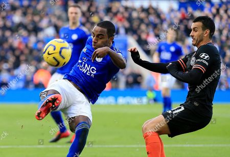 Leicester's Ricardo Pereira, left, duels for the ball with Chelsea's Pedro during the English Premier League soccer match between Leicester City and Chelsea at the King Power Stadium, in Leicester, England