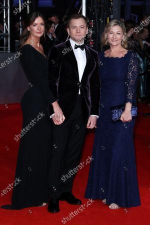 Stock Photo of Emily Thomas, Taron Egerton and his mother
