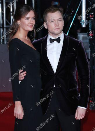 Taron Egerton and Emily Thomas
