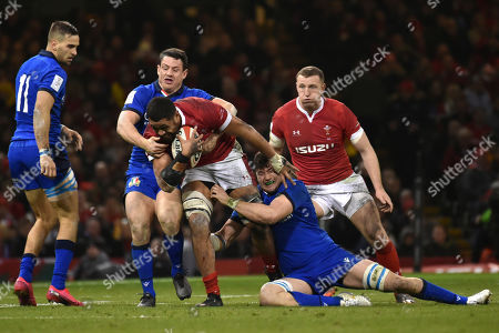 Stock Image of Wales Taulupe Faletau, centre, is tackled by Italy's Sebastian Negri, right, and Italy's Leonardo Sarto, left,during the Six Nations rugby union international between Wales and Italy at the Principality Stadium in Cardiff, Wales