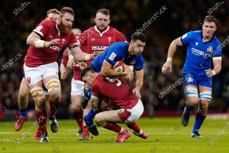 Stock Picture of Italy's Leonardo Sarto (C) is tackled by Wales' Tomos Williams (C-L) during the Six Nations rugby match between Wales and Italy at the Principality stadium in Cardiff, Britain, 01 February 2020.