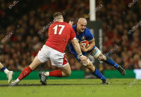 Marco Lazzaroni of Italy is tackled by Rob Evans of Wales