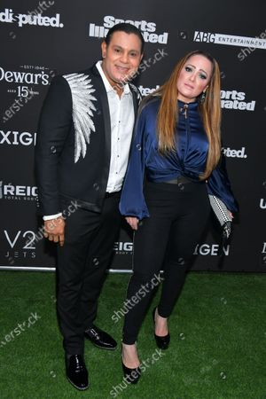 Stock Photo of Sammy Sosa and guest