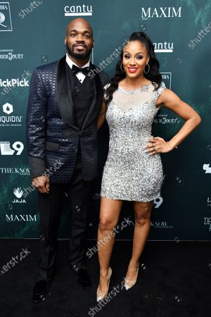 Stock Image of Adrian Peterson and Ashley Brown Peterson