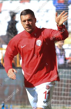 Antalyaspor's Lukas Podolski, waves to fans as he warms up prior to a Turkish Super League soccer match between Antalyaspor and Ittifak Holding Konyaspor, in Antalya, Turkey, . Podolski was a substitute and was not used in the match