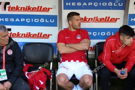 Antalyaspor's Lukas Podolski, centre seats on the bench prior to a Turkish Super League soccer match between Antalyaspor and Ittifak Holding Konyaspor, in Antalya, Turkey, . Podolski was a substitute and was not used in the match