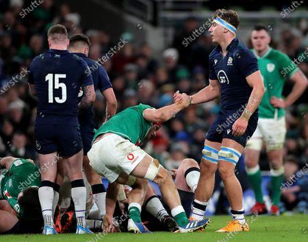 Ireland vs Scotland. Ireland's Josh van der Flier helped up by Jamie Ritchie of Scotland