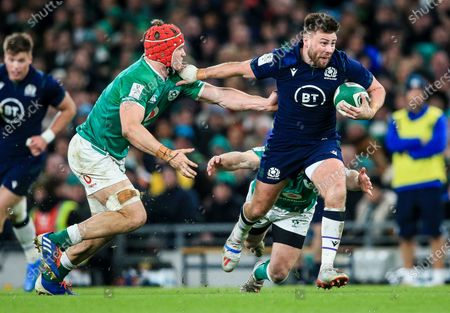 Ireland vs Scotland. Ireland's Josh van der Flier with Ali Price of Scotland