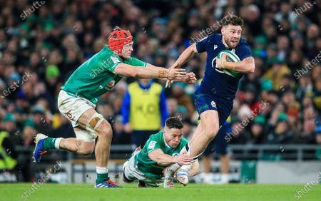 Ireland vs Scotland. Ireland's Josh van der Flier and John Cooney with Ali Price of Scotland
