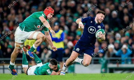 Stock Image of Ireland vs Scotland. Ireland's Josh van der Flier and John Cooney with Ali Price of Scotland